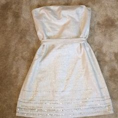 Strapless Shimmer Dress Strapless shimming Ann Taylor dress. With a tie belt Ann Taylor Dresses