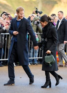 That is one cute bag Megan! Prince Harry and Meghan Markle visit Cardiff, Wales, UK - 18 Jan 2018