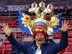 A fan looks on before the Men's Ice Hockey Quarterfinal Playoff between Sweden and Slovenia