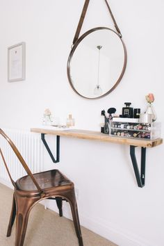 13 Tips for Decorating a Small Bedroom | Hunker | In this, you're essentially just building a shelf and calling it a vanity, but if your bedroom space is scarce, this might be the way to do a workspace in your room. All you need to do is find a seat that doesn't take up too much space and a pretty mirror (which will also open up the room).