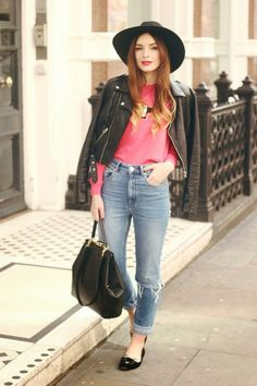 Black leather jacket with pink red blouse and sky blue casual jeans and black leather hand bag and black sexy cap