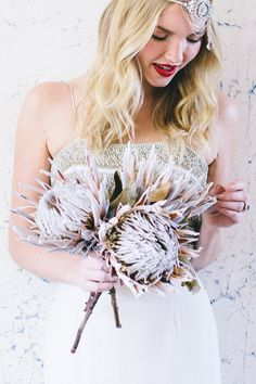 protea bouquet, photo by Natasha Hurley http://ruffledblog.com/winter-whites-wedding-inspiration #kingprotea #bouquets #flowers