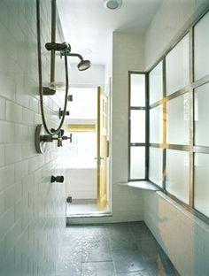 Walk through shower!  This would be perfect when Quinn and I have our own bathrooms; meet in the middle! I can dream right!