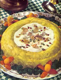 Creamed Tuna in a yellow-jellied noodle ring. There are noodles in that jello. And tuna in the middle. Apparently crazy people wrote the recipes in the 60's.