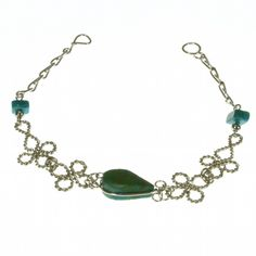 An eye-catching bracelet featuring a central, polished, chrysocolla teardrop within a twisted, alpaca silver chain with two, polished, turquoise chip beads. Only £7.99