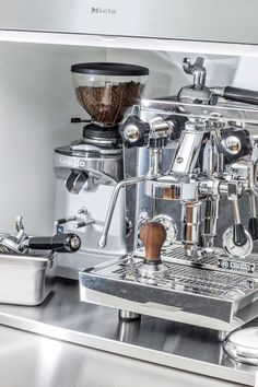 The coffee station features a professional-grade Rocket Espresso machine. Jang and King designed a stainless-steel pullout shelf for a cream and sugar station.  Courtesy of Joseph Dominguez.