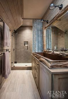 Rustic Bathroom with Greywash Shiplap Walls, Natural River wood wraps around the sides of a copper sink for a unique touch. Rustic Bathroom with Greywash Shiplap Walls #RusticBathroom #bathroom #GreywashShiplap #Shiplap #BathroomShiplap Meridy King Interiors via Atlanta Homes & Lifestyles