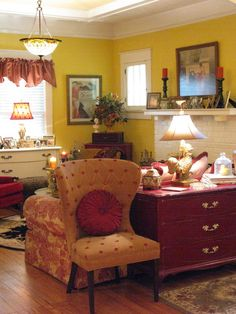 I love how she divided the room.  That dresser is adorable in red.