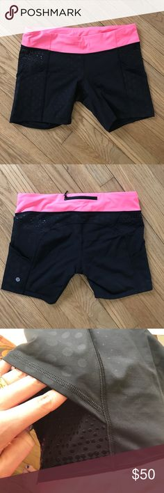 Sz 12 lululemon bike shorts These have grippy dots on both thighs which are advertised to help hold your tank/top down! Both legs also feature a slip-in pocket on the outside and a hidden inner pocket in both sides of the waistband. Zipper pocket on the back of the waistband for card/keys, and drawcord for adjustable fit. Fabric has subtle black dots on the non-grippy portions as well. Excellent condition. Waistband is a coral color. lululemon athletica Shorts