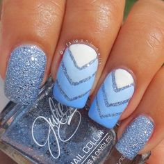 Blue glitter nail art design with v-shaped details and a gradient inspired nail art as base.
