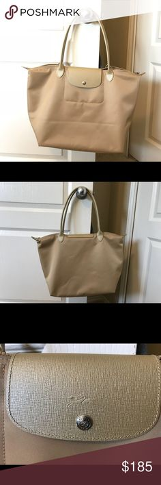 """NWOT Longchamp Le Pliage Néo Large Tote Bag - Gold NWOT Gorgeous Authentic Longchamp bag in the new """"Gold"""" color.  My mom recently bought this in Paris for me at a Longchamp store but the size is just too big for my everyday needs. The color is AMAZING and is just now being offered in the States at Neiman Marcus. Gorgeous, gorgeous bag!  Never been used and in perfect condition.  Smoke-free home.  (Wrinkles shown are from it being folded.)…"""