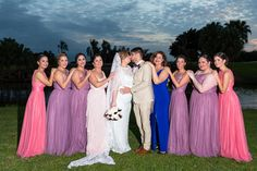 Our beautiful Bride and Groom with their bridesmaids in front of the famous waterfall hole on the Bonaventure Golf Course in Weston, Fl. Outside photography, Golf Course, Purple dresses