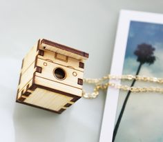 Wooden Polaroid locket necklace on Etsy. You can keep a little keepsake in there!