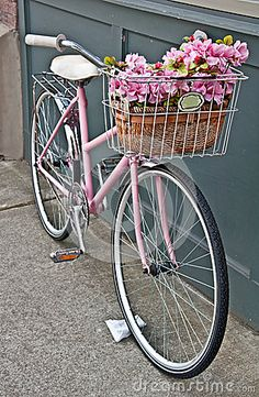 Vintage Pink Bicycle with Pink Flowers by Joyfuldesigns, via Dreamstime