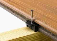 Trex Hideaway Universal Fastener with grooved composite deck board