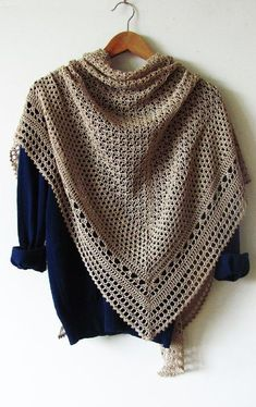 """• Hourglass is a big, beautiful triangle-shaped shawl worked from top to down. You will love the original combination of simple crochet stitches and delicate lacy look of this shawl.• Solid colors and 3-4 ply yarns will work best to show off the design.Pattern both written and charted.Finished size: wingspan 67""""/170 cm, depth 35.5""""/90 cm.Materials needed:• 5 skeins of Light fingering weight yarn, about 245 yards (225 meters) per 50 grams. You will need approx. 1100 yards (..."""