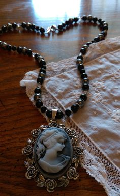 War of the Roses - The White Queen's Cameo Necklace/ Rose Cameo Necklace/Pendant Necklace/beaded necklace with pendant/black necklace by LouisianaBayouBeads on Etsy