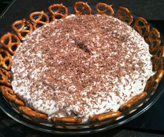 Snickers Dip    Ingredients:        2  (8 ounce) packages of cream cheese, softened      1  (8 ounce) Cool Whip      1/4 cup brown sugar      6 Snickers bars, chopped         Directions:    Mix all ingredients together.    Chill overnight to better blend the flavors.    Serve with pretzels or graham crackers.