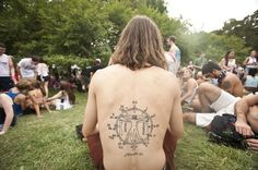 Cole Willis of Media sports his tattoo he calls the circle of musical fifths during the Made in America Concert. (RON TARVER / Staff Photographer)