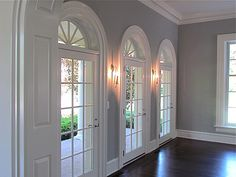 Love the windows and colors, grey walls white trim and dark wood floors.