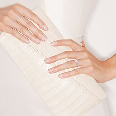 Brides.com: . The right nail color can take your wedding-day look to glamorous new heights. And though you may want to save the bevy of funky new nail art styles for your bachelorette party, adding pizzazz to a classic—the ever-elegant French manicure—offers the perfect compromise. It is always on-trend, has as much versatility as it has class, and guess what? Switching up the colors or materials (think appliqués and glitters), can make it feel brand new and oh-so you. Whether you want to…