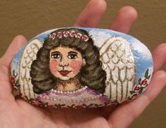Angel painted onto rock by TinyAna on DeviantArt