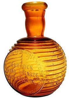 Babcock Hand Grenade Non-Freezing, Amber, 8 inch.A Babcock Hand Grenade bottle in amber