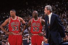Phil Jackson talks to Scottie Pippen and Michael Jordan during Game 4 of the Eastern Conference Semifinals in 1996. Jordan and Pippen combined for 36 points, 15 rebounds, 13 assists and four steals in the Bulls' 94-91 win at New York.