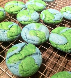 Earth Day cookies. Box of white cake mix, 1/2 c butter, 1 egg. Divide dough in half and dye. Make balls of each colour, mash 2 together slightly, freeze 20 min & bake 350 for 12 min.