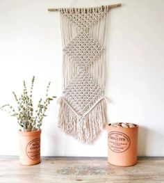 Bohemian fringed macrame wall hanging with natural cotton rope and a tree branch. 70s, minimal, ecological, modern, vintage