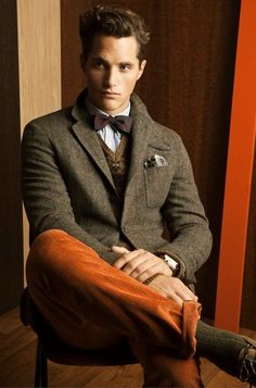 Mix of Orange Corduroy Pants, Tweed Jacket, Bow Tie, and Nerd Specs. Men's Fall/Winter Fashion.