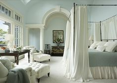 Master Bedroom Beauty! Love the white with soft colors...rug, dark wood floors... Beautiful retreat....