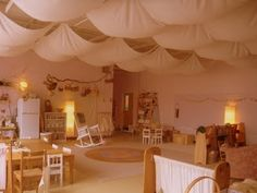 Waldorf classroom ~ so pretty and peaceful! Whats up with the draped ceiling? I don't know, but it does seem calm and cozy. Probably acoustically pleasing too.