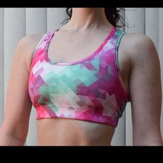 "Reebok Pink Sports Bra Reebok Sports Bra on a fun kaleidoscope pattern!  Reebok logo on the left front strap. Size: XS. Band measures 11.5"" unstretched. Reebok Intimates & Sleepwear Bras"