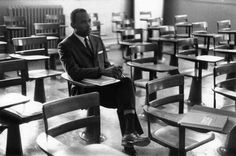 "Photos of James Meredith's first day of classes at the University of Mississippi. The images are now a part of the Ed Meek Collection at the Meek School of Journalism and New Media at the University of Mississippi.    "" [...] And then it's just Meredith, sitting among empty desks littered with books and bags left by students in a rush to flee a room he's in — because he's in it."""