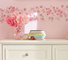 How about doing this with real tisue paper flowers attached to the wall with velcro or that poster hanging gummy stuff