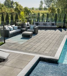 Modern backyard with pool  Rinox aspen slab