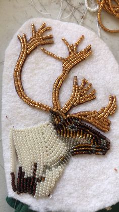 Alaskan caribou made out of beads - Made Joyce Roberts of Eagle, AK. This piece was created for a collar made for Teisha Simmons. Native Beading Patterns, Bead Embroidery Patterns, Beadwork Designs, Seed Bead Patterns, Beaded Embroidery, Loom Patterns, Indian Beadwork, Native Beadwork, Beaded Moccasins
