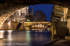View of Petit Pont from under Pont Saint-Michel on the Seine river in Paris