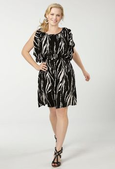 bcea372e101 This printed crepon plus size dress has goddess-like draping details with a  unique textured fabric