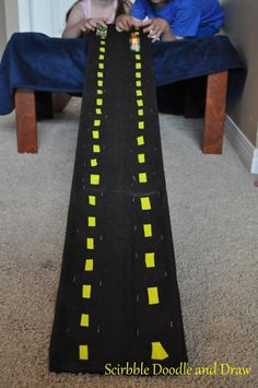 DIY race track for a hotwheels cars birthday party.