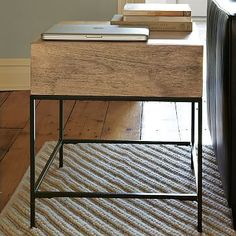 Love this table / nightstand. a nice sized drawer and the rustic wood is the best. Rustic Storage Side Table #westelm