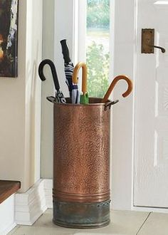 Our exclusive Copper Riveted Bucket is brimming with fine details. Create an intriguing look by filling it with branches, or give miscellaneous umbrellas a more refined place to reside.