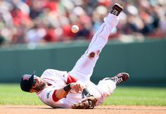 BOSTON, MA - APRIL 16: Dustin Pedroia #15 of the Boston Red Sox fields the ball against the Tampa Bay Rays on April 16, 2012 at Fenway Park in Boston, Massachusetts. (Photo by Elsa/Getty Images)