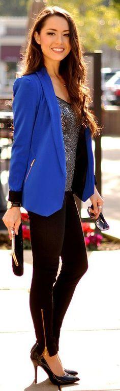 Blue colored blazer, black jeans and sparkling shirt