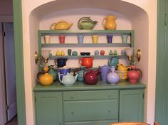 My pottery collection.  It's always bizarre to find photos of my house on Pinterest.  Years of doing the Flickr thing have invited lots of peeps into my home.  :)