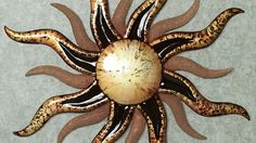 décoration murale en métal beau soleil