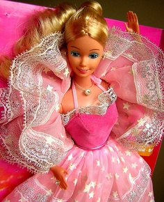 I Love this one! The stars glow in the dark<3 80's Dream Glow Barbie my ABSOLUTE favorite Barbie EVER! For real.