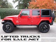 Lifted Red Jeep Wrangler Unlimited