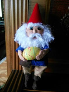 My latest doll. He is a Gnome on Unfound Easter Egg Duty. I have not named him yet.  As you can see the glue on his hand is still not dry LOL.